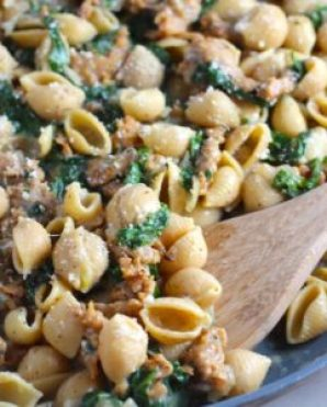 Shell Pasta with Italian Sausage and Kale in a pan. It's loaded with a salty homemade Chicken Italian Sausage flavored with garlic and fennel in a parmesan, garlic and kale sauce.