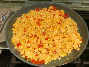 Corn and red peppers in pan for Creamy Corn and Blackened Chicken skillet dinner
