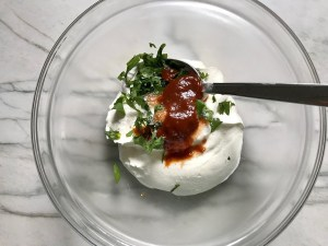 Sour Cream, cilantro, and chipotle in adobo in a bowl for for Grilled Shrimp Tacos
