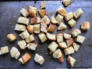 Toasted bread cubes on a sheet pan for this Chicken Panzanella Salad Recipe.  It's absolutely delicious.