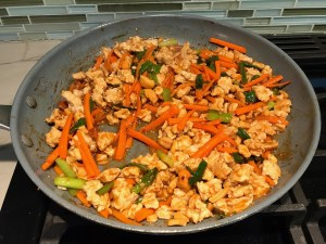 Cashew Ground Chicken and carrots cooked in a pan for this Cashew Chicken Lettuce Wrap Recipe