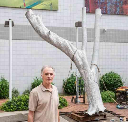 Robert Lobe with his sculpture X