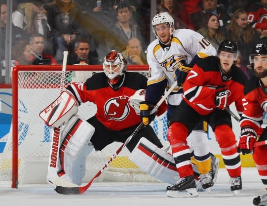 Cory Schneider #35 and Jon Merrill #7 of the New Jersey Devils defend against Colton Sissons #10 of the Nashville Predators during the second period at the Prudential Center on December 20, 2016 in Newark, New Jersey. (Bruce Bennett | Getty Images)