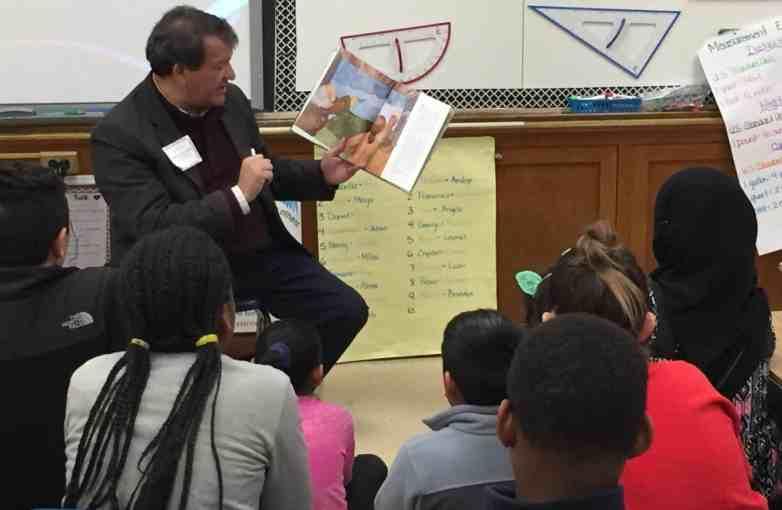 State Senator George Latimer reads to children