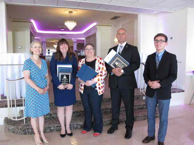 NRCCS president Stephanie Tomei with honorees Colleen Gardephe, Amy Tietz, and Det. Chris Greco, and scholarship winner Sebastian Gonzalez