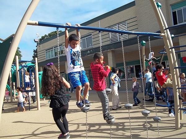 Students enjoying one of the new elementary school playground sets.