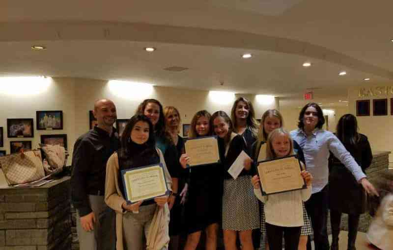 District students with their certificates from the Italian Heritage and Culture Month ceremony.