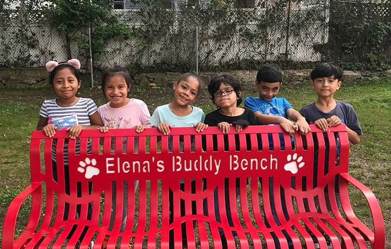 Jefferson Elementary School unveiled a new Buddy Bench in memory of teacher Elena Braia, who passed away two years ago. Buddy Benches help school children make new friends.