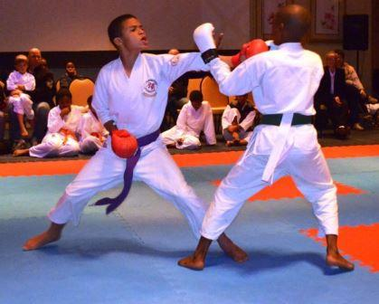 STING LIKE A BEE: Keanu Kievitss, left, from Grahamstown ECSR lands a hard jab at Ayakhanya Nthanjeni from Port Elizabeth at the SASKA East Coast Karate Open (Secko) Championship last weekend. Both boys fought hard for points and chased each other around the arena, with Kievitts beating his opponent in the final round Picture: LOUISE CARTER
