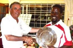 CROQUET CHAMP: Vice president of the SA Croquet Association Paul McCreadie congratulates open singles champion Victor Dladla at the prize giving for the SA Nationals Golf Croquet Tournament recently Picture: JON HOUZET