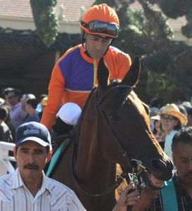 Beholder flashes a smile to her fans as she enters the walking ring before the Zenyatta Stakes. Photo by Terri Keith.