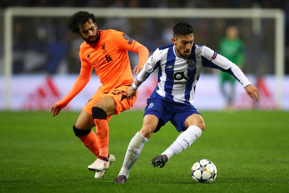 Telles battles with Liverpool's Mo Salah in the Champions League