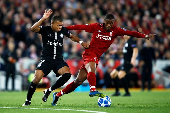 Wijnaldum battles World Cup winner Kylian Mbappe during Liverpool's Champions League win over PSG