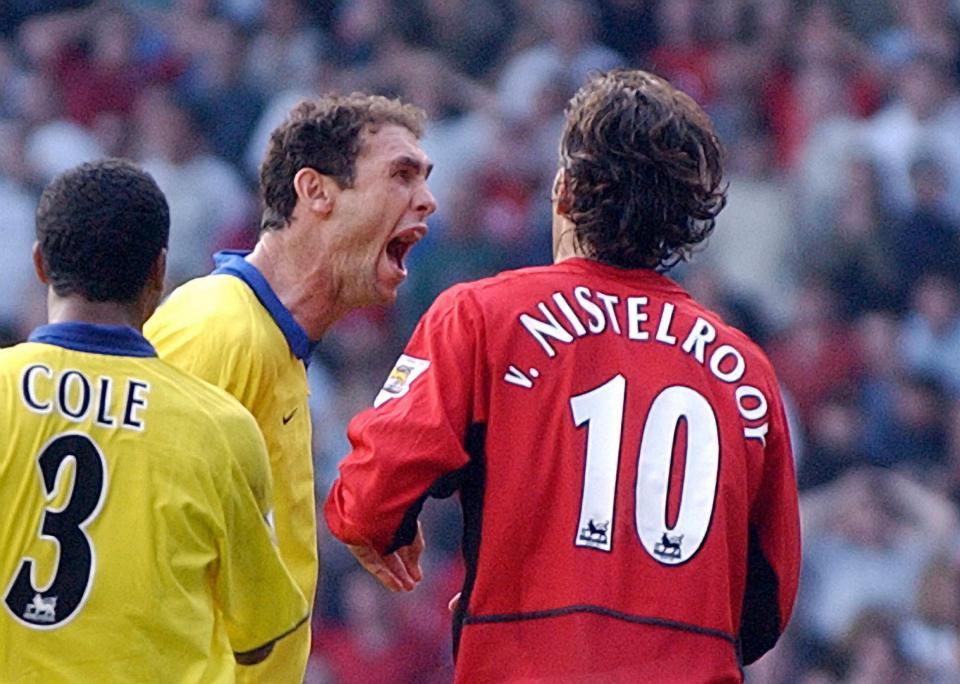 Martin Keown meets Ruud van Nistelrooy after losing his penalty in 2003