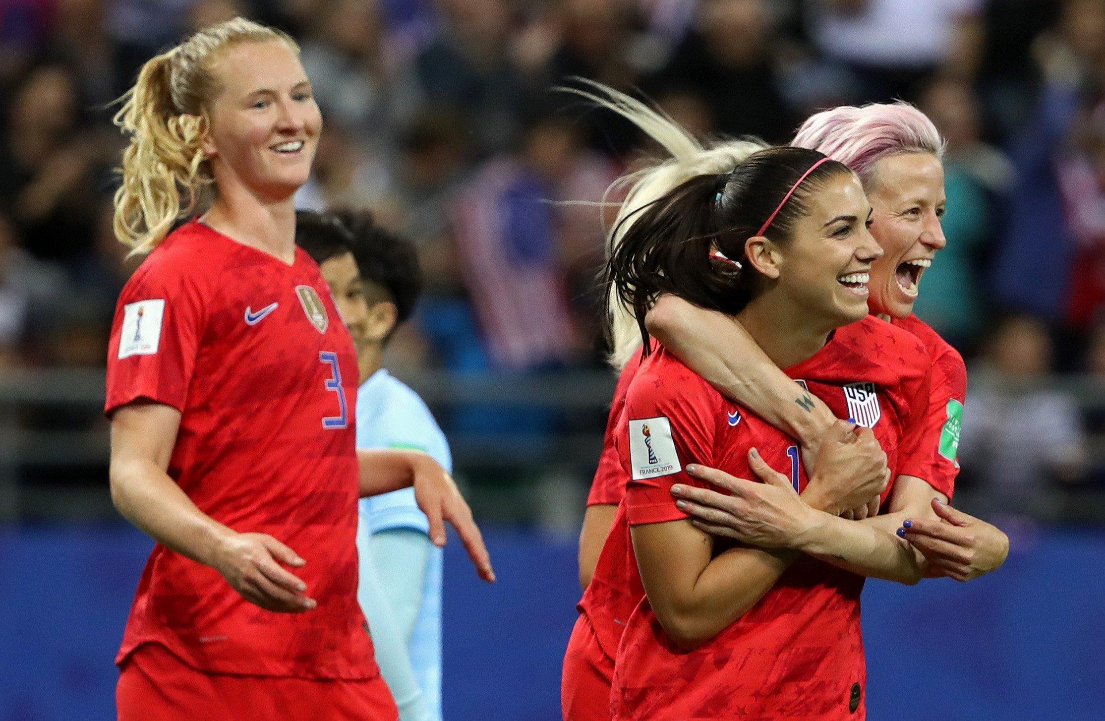 Alex Morgan celebrates one of her five goals against Thailand