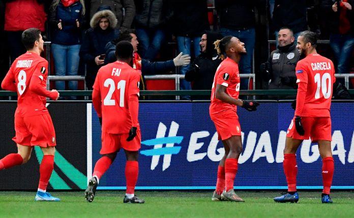 Standard Liege celebrate their goal against Arsenal