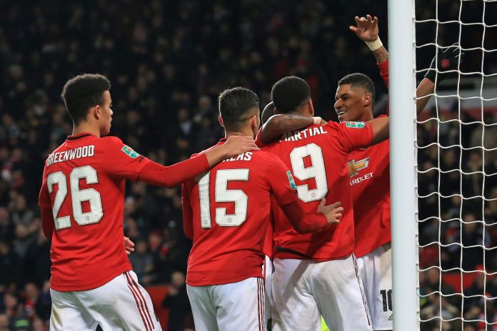 The United players celebrate after their emphatic win over Colchester at old Trafford