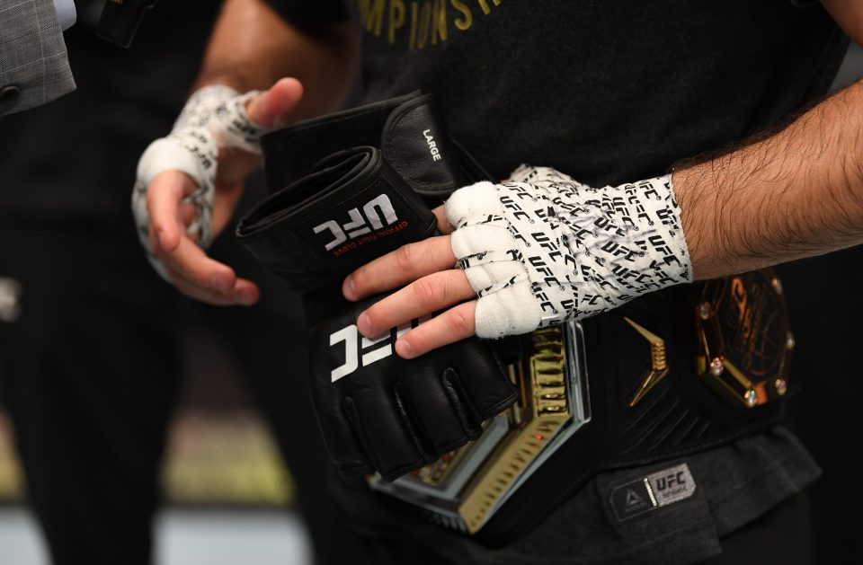 Khabib put his gloves in the center of the octagon at UFC 254