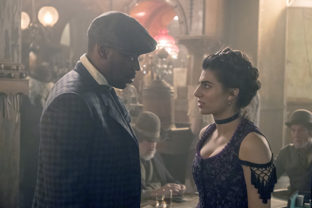 "TIMELESS -- ""A History of San Fran"" Episode 210 -- Pictured: (l-r) Malcolm Barrett as Rufus Carlin, Claudia Doumit as Jiya -- (Photo by: Ron Batzdorff/NBC)"