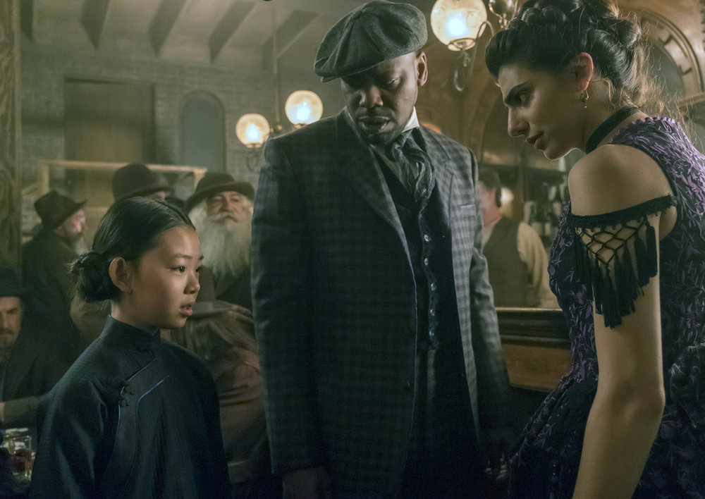 "TIMELESS -- ""A History of San Fran"" Episode 210 -- Pictured: (l-r) Megan Liu as Fei Yunshan, Malcolm Barrett as Rufus Carlin, Claudia Doumit as Jiya -- (Photo by: Ron Batzdorff/NBC)"