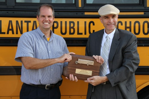 Wiliam Cook of the Georgia Environmental Protection Division presents the Blue Sky Award to John Franklin, APS Executive Director of Transportation
