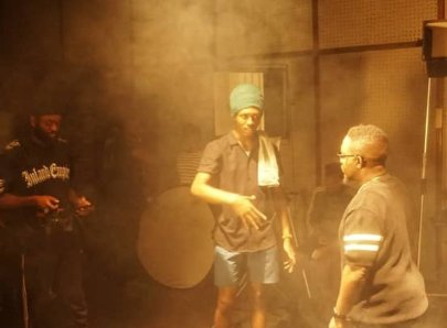 Kelvin Nuel with MI on the set of a music video