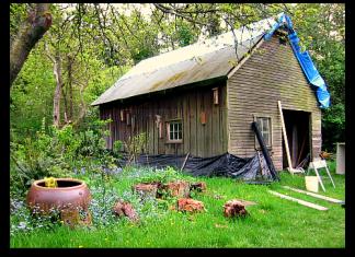 blue tarp roof barn