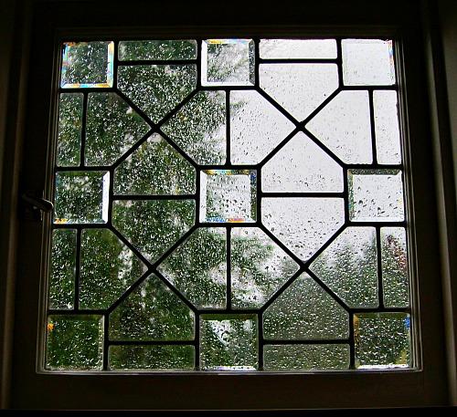 beveled glass window rainy day