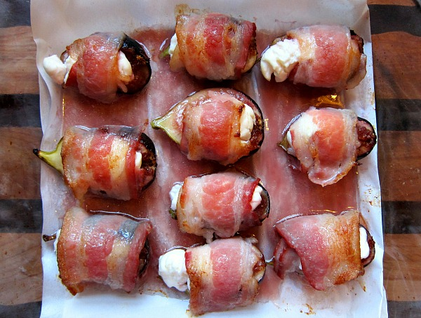 Fresh figs stuffed with goat cheese wrapped in bacon