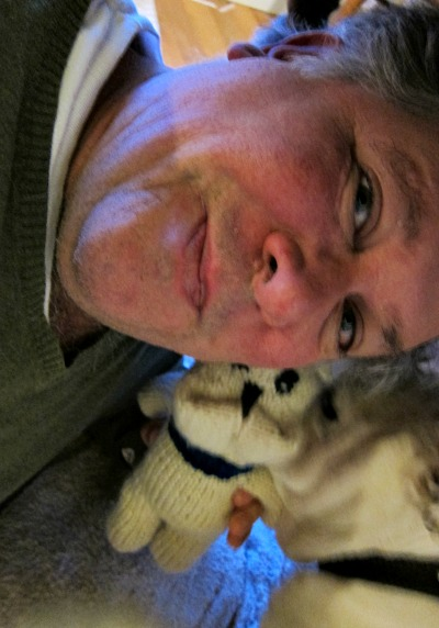Selfie quality goes down when holding onto a knitted bulldog, while holding off a real bulldog.