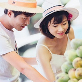 Asian couple shopping for fruit