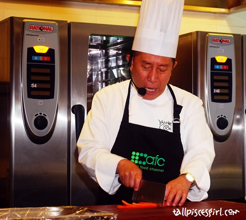 Chef Martin Yan started by cutting some fruits