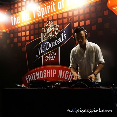 Have a sip of whisky while watching Victor Chan DJ-ing