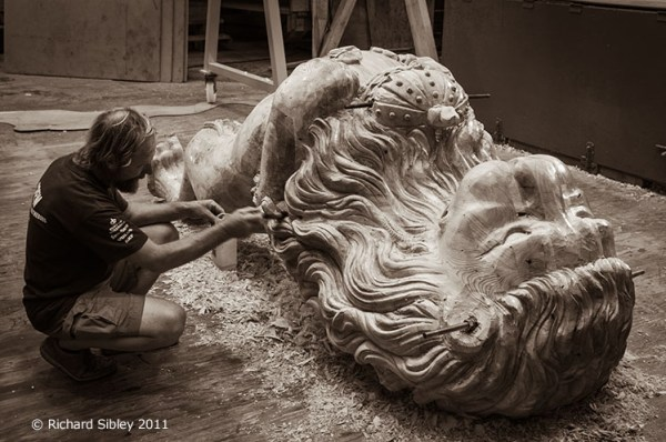 Andy Peters, Maritima Woodcarving. Working on the Lion figurehead for Hermione. In the dock, Rochefort. France.