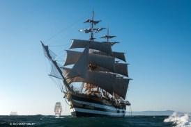 Italian full rigger Amerigo Vespucci. Background vessels, Creoula and Christian Radich