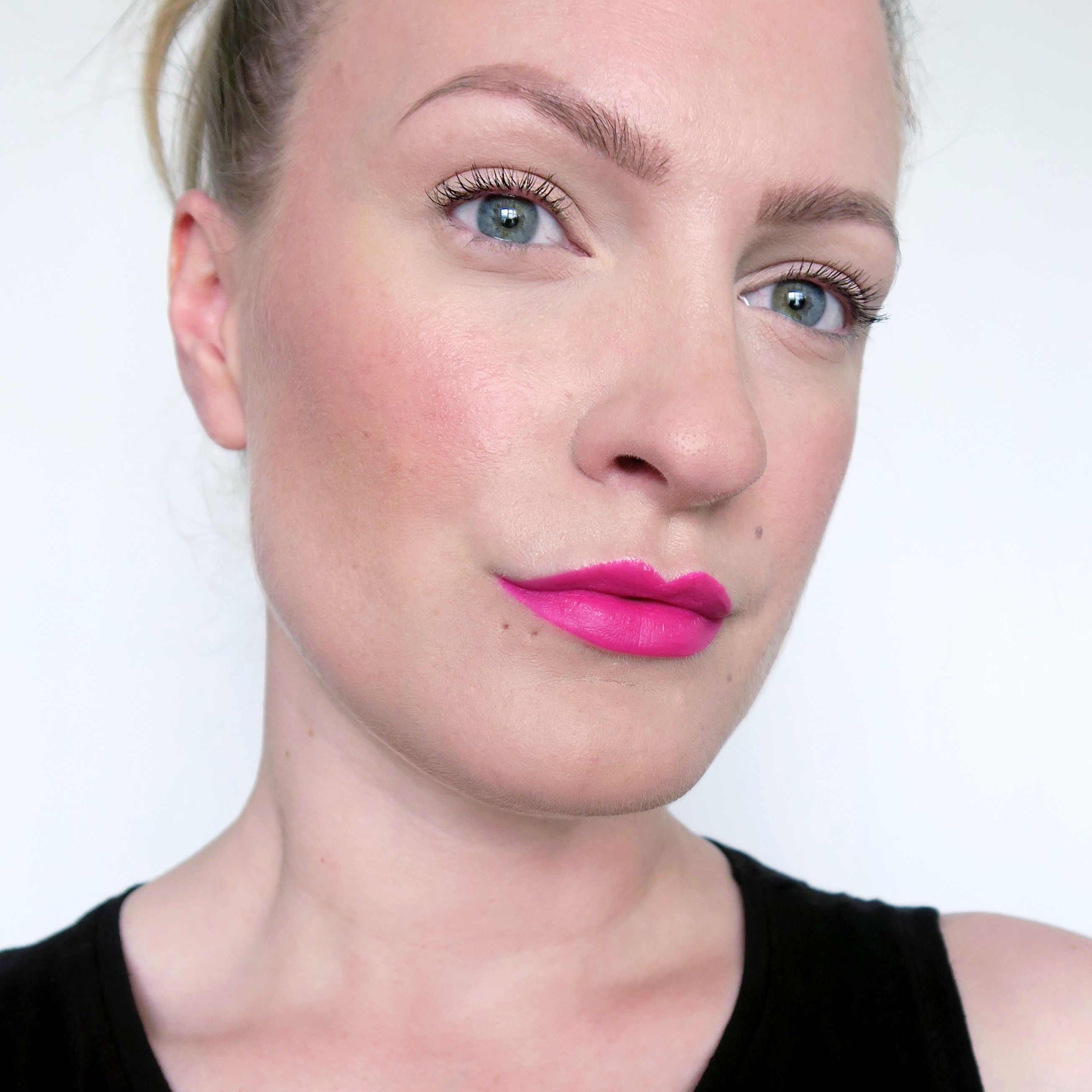 Hot pink lipstick, summer make up inspiration.