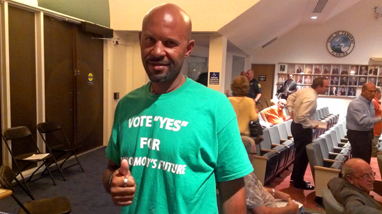 Green T-Shirts in favor of development were handed out to participants at Monday night's marathon meeting.  Photo by George Stroker.