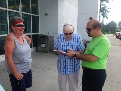 Residents signing the petition at the Tamarac Public Library.