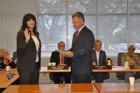 MIchelle Gomez is sworn in by City Manager Michael Cernech