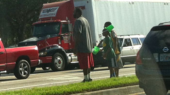 This family was panhandling on this major roadway. I was afraid for their safety.