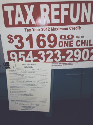 Coral Springs sign pictured being sent to a business with a citation on it.