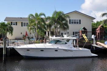 Hage and Pozzuoli's yacht in back of Hage's Coral Ridge Country Club home in Fort Lauderdale.