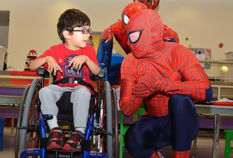 Felipe Guzman of Tamarac receives his custom wheelchair at ARC Broward