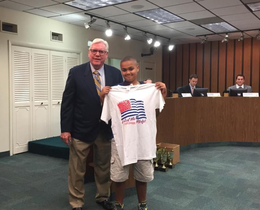 How does Coral Springs get those children to come to meetings?  Simple: they get to say the pledge, be on TV, receive a nifty t-shirt and get a photo op with the mayor.