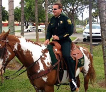 Sheriff Scott Israel riding Hot Chocolate - photo courtesy  Donald Maines