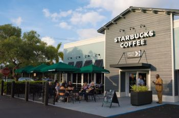 Outdoor seating area at new Starbucks location in Lauderhill Florida.