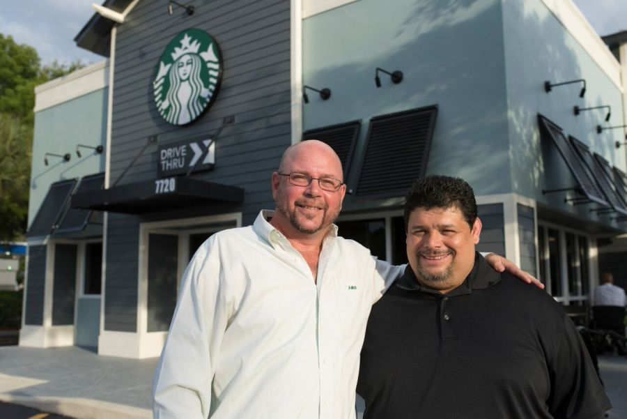 Starbucks District Manager Artie Dohler and Store Manager Eddy Salazar.  - Photos by Adam Baron