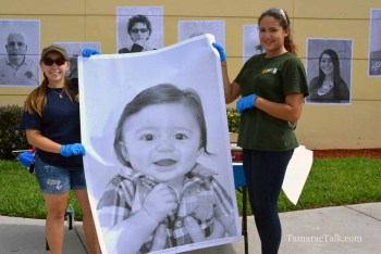 BSO Explorers and JP Taravella Students Rita Lucas and Daniela Gallego hold up the photo of the youngest participant.