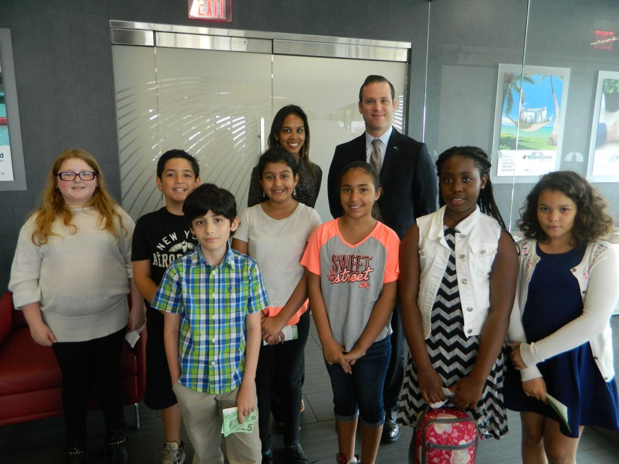 KAPOW Program Director Tania Reynolds and BankUnited Senior Vice President and Small Business Credit Officer Michel Vogel pictured with students from Tamarac Elementary.