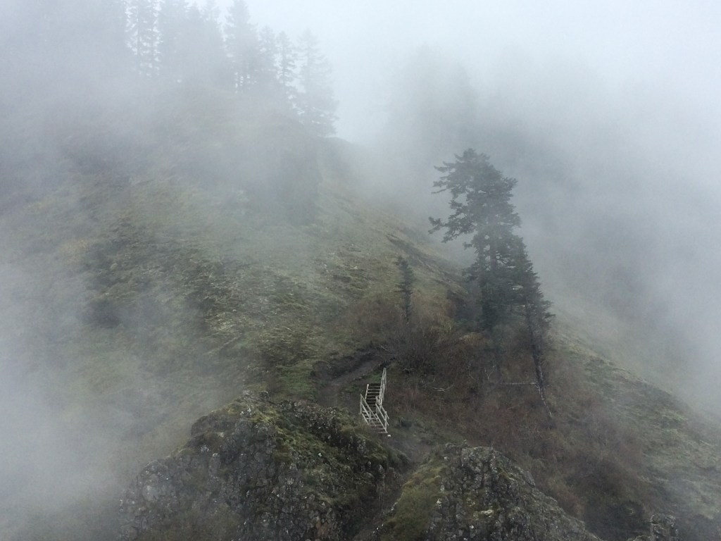 staircase on mountain slope in the clouds